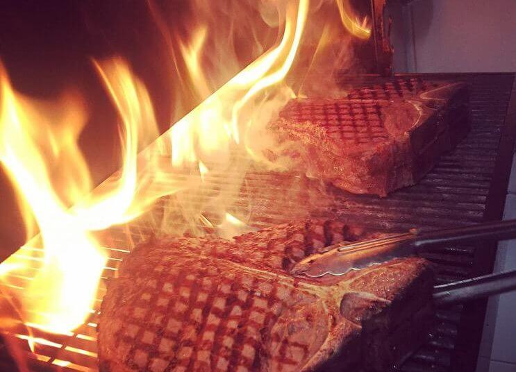 Taste the story of beef & glory, Porterhouse Steak on fire